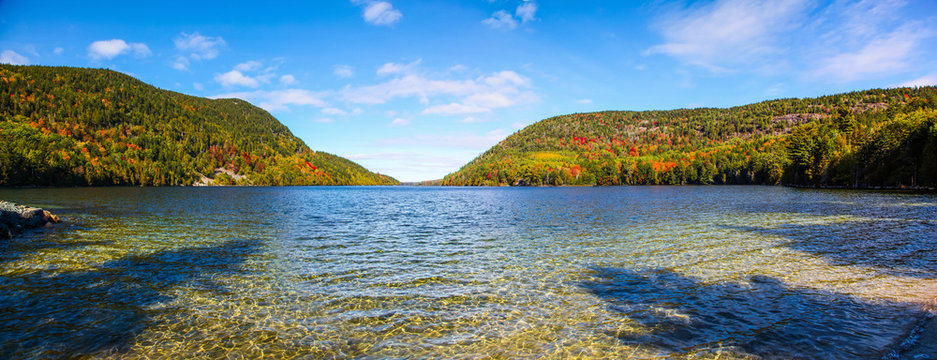 Panoramic view of the rippling water and fall colors of Long Pond in Acadia National Park