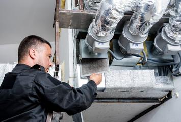 Fototapeta Ventilation cleaning. Specialist at work. Repair ventilation system (HVAC) obraz