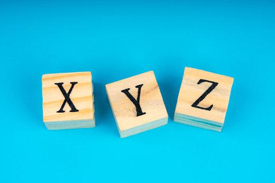 xyz letters written on wooden cubes
