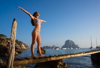 Ibiza cala d Hort girl pier sunset Es Vedra