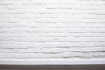 White brick wall with wooden floor can be used for background
