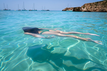 Ibiza bikini girl swimming clear water beach