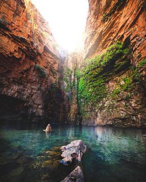 adventurous woman in waterhole