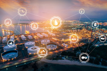 Light oil refinery at twilight with physical system icons diagram on industrial factory. Industry on technology 4.0 concept support with double exposure. Wall mural