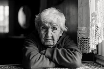 Portrait of a lonely sad old woman. Black and white photo. Wall mural