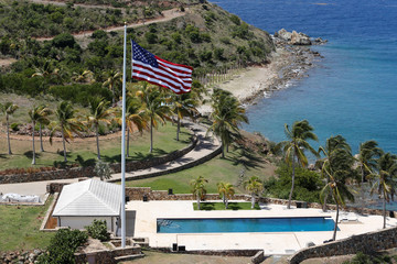 An American flag flies next to a swimming pool at Little St. James Island near Charlotte Amalie