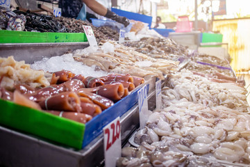 The fresh seafood such as fish squid shell on the shelfs to sell in the fresh market. The number in the picture is the price in Thai Baht per kiligram.