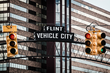 Flint, Michigan downtown gateway sign showing Vehicle City. Known widely for their water quality and safety issues.