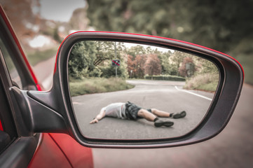 Rearview mirror with a man hit by a car