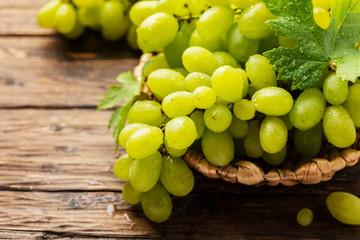 Fototapeta Sweet yellow grape with leaves obraz