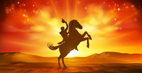 A cowboy riding a horse in silhouette against a desert landscape sunset background