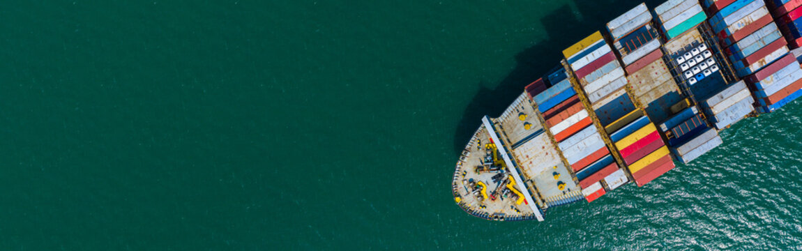 Container cargo ship carrying container for import and export, business logistic and transportation by container ship boat in open sea, Aerial view container ship with copy space for design banner web