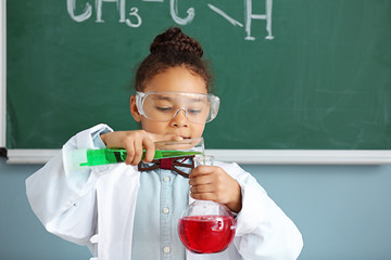 Little African-American scientist in laboratory