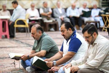 Iraqi worshippers read Quran at a mosque in Dowlatabad neighbourhood in Tehran