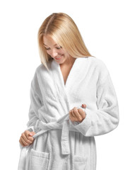 Wall Mural - Beautiful young woman in bathrobe on white background