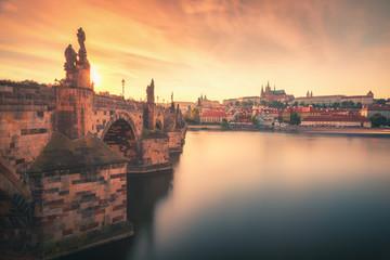 Sunset view over Charles Bridge (Karlov Most), Vltava river and Prague Castle in summer in Prague, capital of Czech Republic