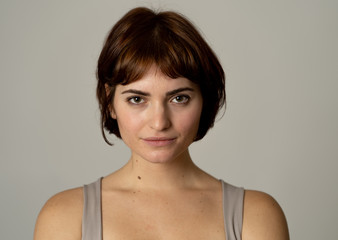Beautiful headshot portrait of young attractive woman with stylish short hair and sensual look