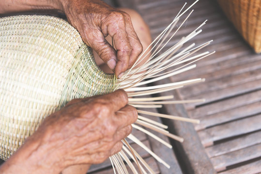 weaving bamboo basket wooden - old senior man hand working crafts hand made basket for nature product in Asian