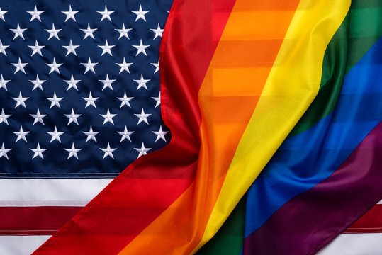 Pride rainbow lgbt gay flag over american flag . Equality diversity freedom in USA concept.