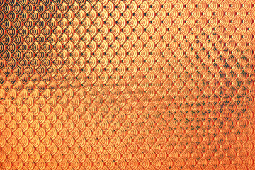 Gold holographic dragon or mermaid fish scales iridescent faux leather texture background..
