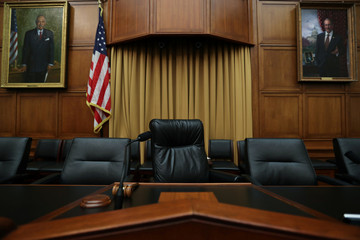 Portraits of former chairmen overlook dais in House Judiciary Committee hearing room on Capitol Hill in Washington