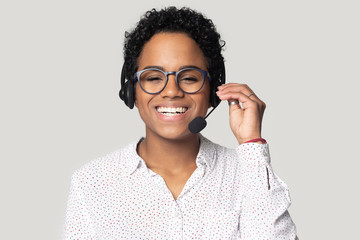 Portrait of smiling biracial female call center agent in headset