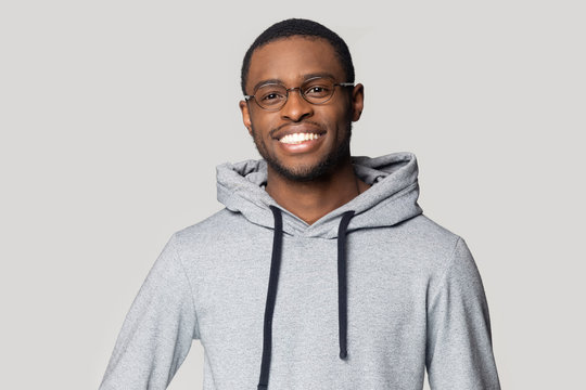 Smiling black male in hoodie posing for picture