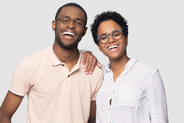 Portrait of smiling ethnic couple posing for picture together