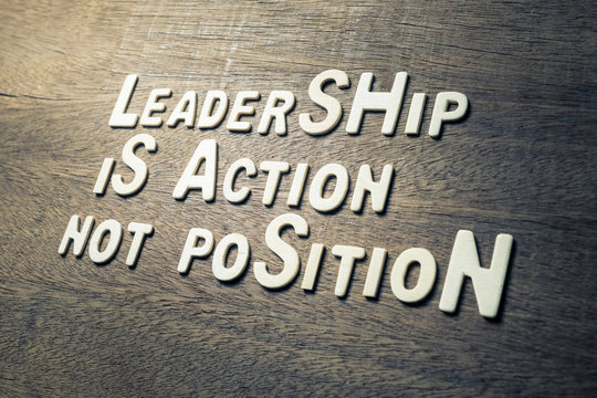 Leadership Quote Concept on Wood Wall