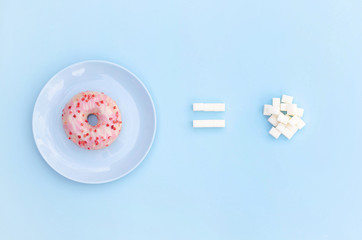Conceptual photo of a donut and the amount of sugar in it.