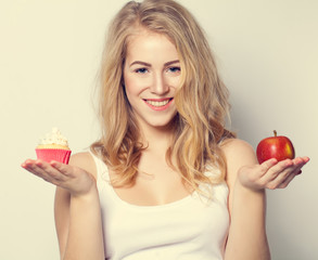 Smiling Beautiful Woman with Healthy and Unhealthy Food. Difficu
