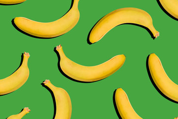 Bananas on a green background. Healthy food, nutrition concept. Creative style, modern art, collage