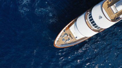 Aerial drone photo of luxury yacht with wooden deck in deep blue sea of iconic island of Mykonos near super Paradise beach, Cyclades, Greece Wall mural