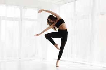 Graceful Contemp Dancer Training In Modern Studio. Copy Space
