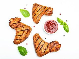 Fototapete - grilled chicken wings, red bbq sauce basil spices on white background
