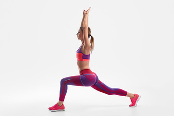 Slim woman doing reverse lunge