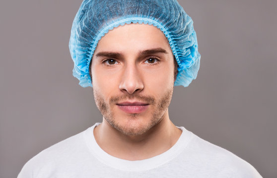 Portrait of young man in blue medical hat