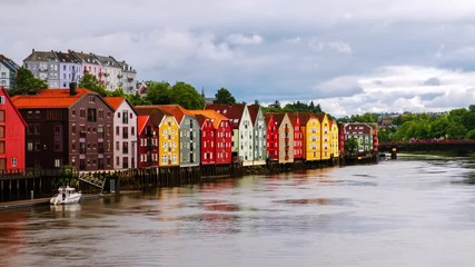 Wall Mural - Trondheim, Norway. City center of Trondheim, Norway during the cloudy summer day. Time-lapse of historical colorful building and grey cloudy sky