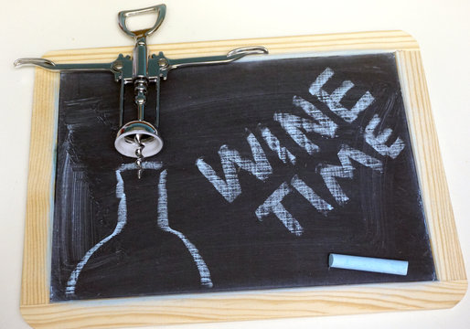 Wine time message on chalkbaord with corkscrew