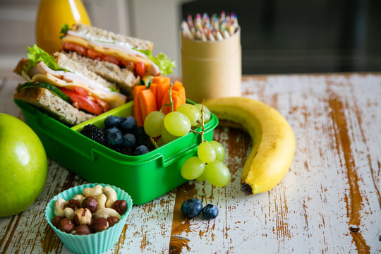 Back to school concept - packed school lunch on kitchen background, copy space