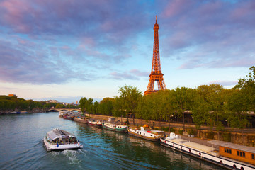France, Paris, Eiffel Tower and tourist boat on River Seine