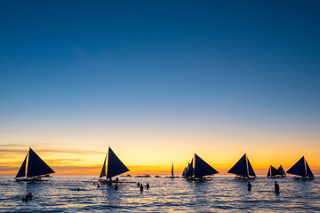 Sailboats at sunset on White Beach, Boracay Island, Aklan Province, Western Visayas, Philippines