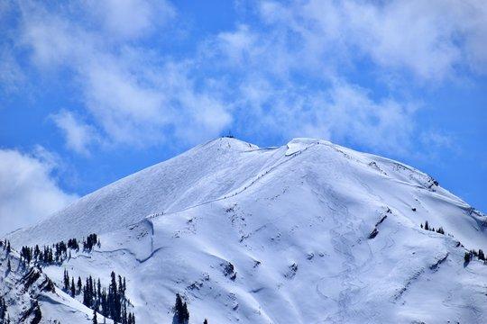 Aspen Highlands Bowl during spring still gets its clients.