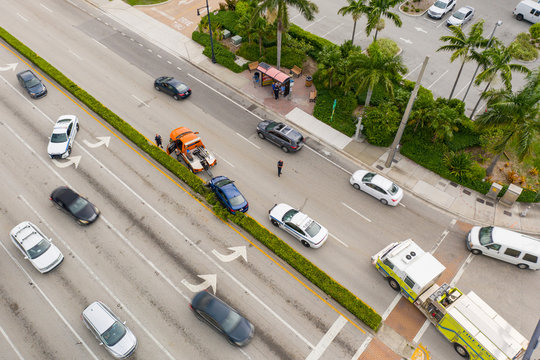 Aerial photo of a car accident with police directing traffic