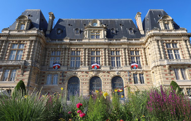 The town hall of Versailles - France. The flowers in the foreground.