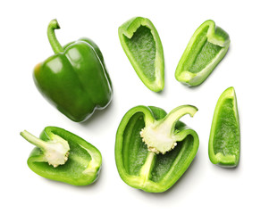 Fototapete - Whole and cut green bell peppers on white background, top view