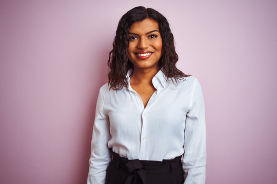 Beautiful transsexual transgender elegant businesswoman over isolated pink background with a happy and cool smile on face. Lucky person.