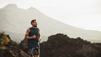 Printed roller blinds Gray traffic Young athlete man trail running in mountains in the morning. Healthy lifestyle concept. Panoramic photo with empty copy space.