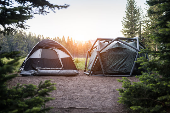 Two modern tents on campsite in Yellowstone National park at sunset time