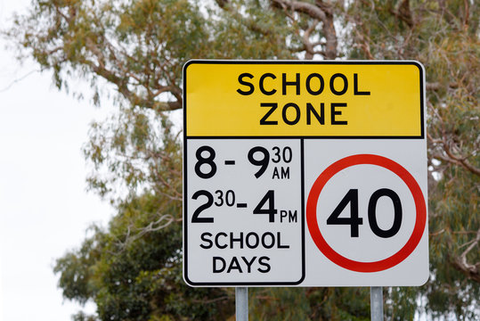 Australian speed road sign in school zone with 40km and times for school days, Victoria Australia